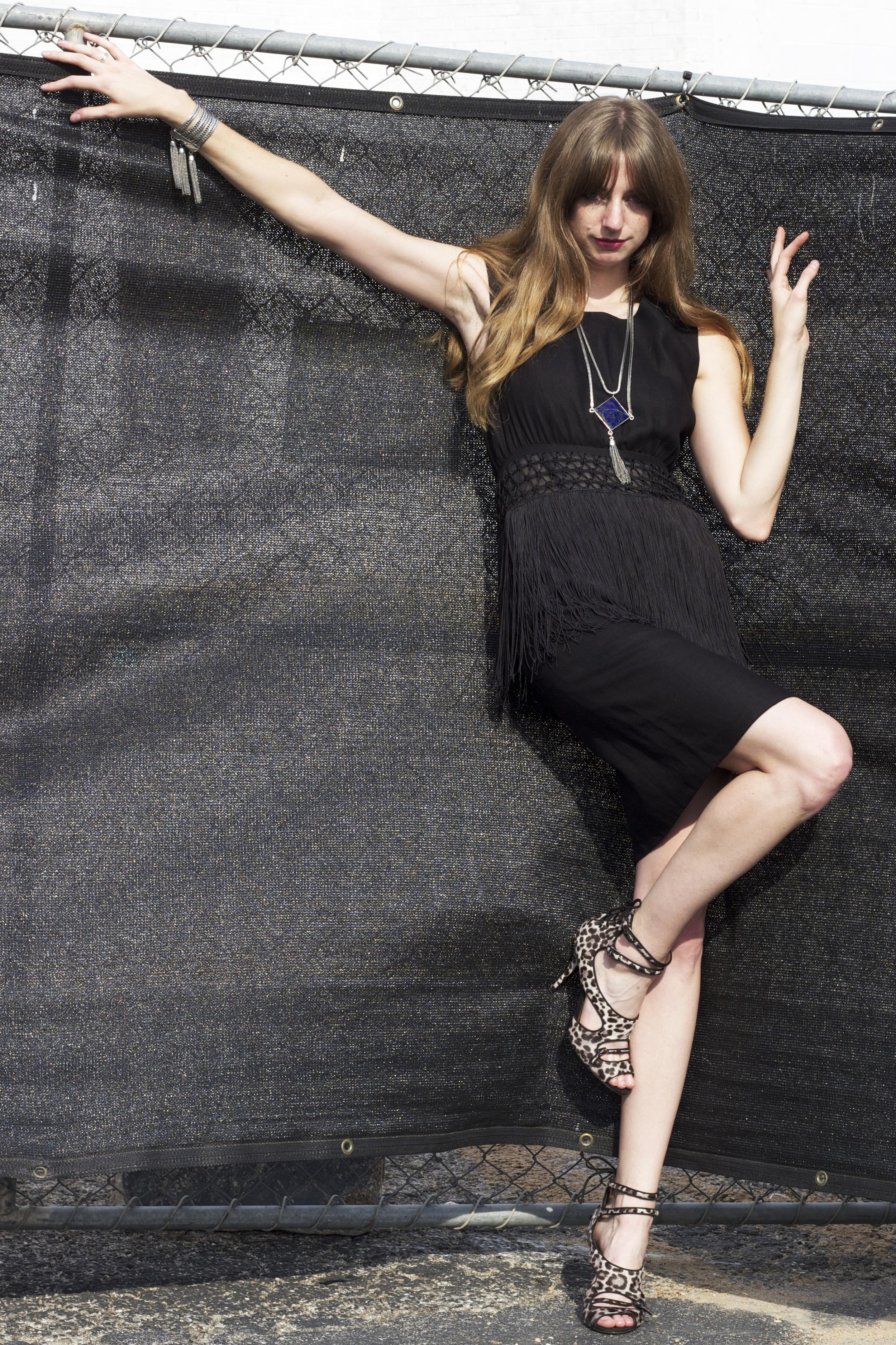 "Black fringe dress -$325 size 4/6,  ManiaMania  ""Noir"" necklace $340,  ManiaMania  ""Magick"" bracelet $295. To purchase please call 512-462-4667."
