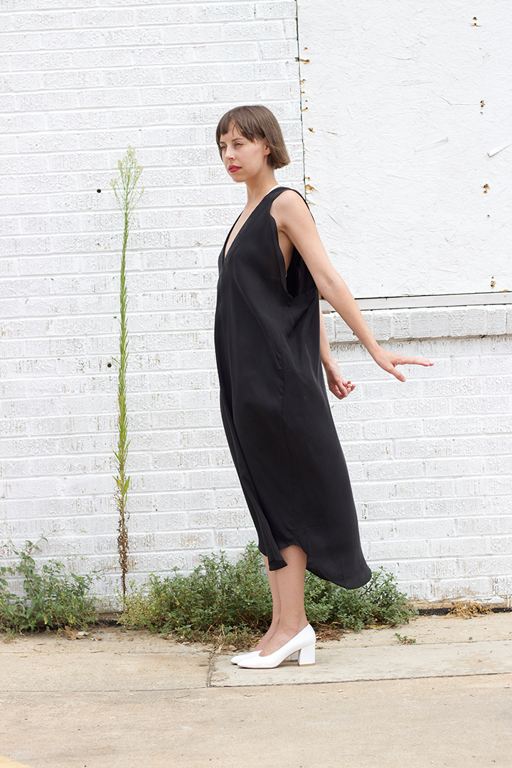 7115 by SZEKI  V-Neck Maxi Dress in Black $195 (One Size).       PRAE    Muir T-Strap Bra in White $165 (sizes XS,S,M,L available)