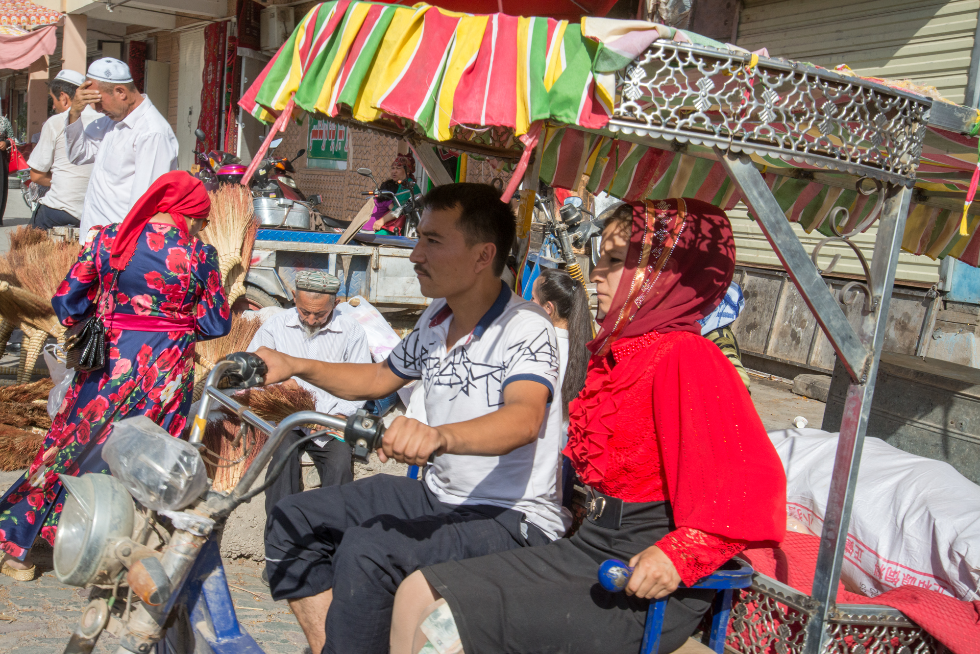 Uyghur Couple on Motorcycle Truck