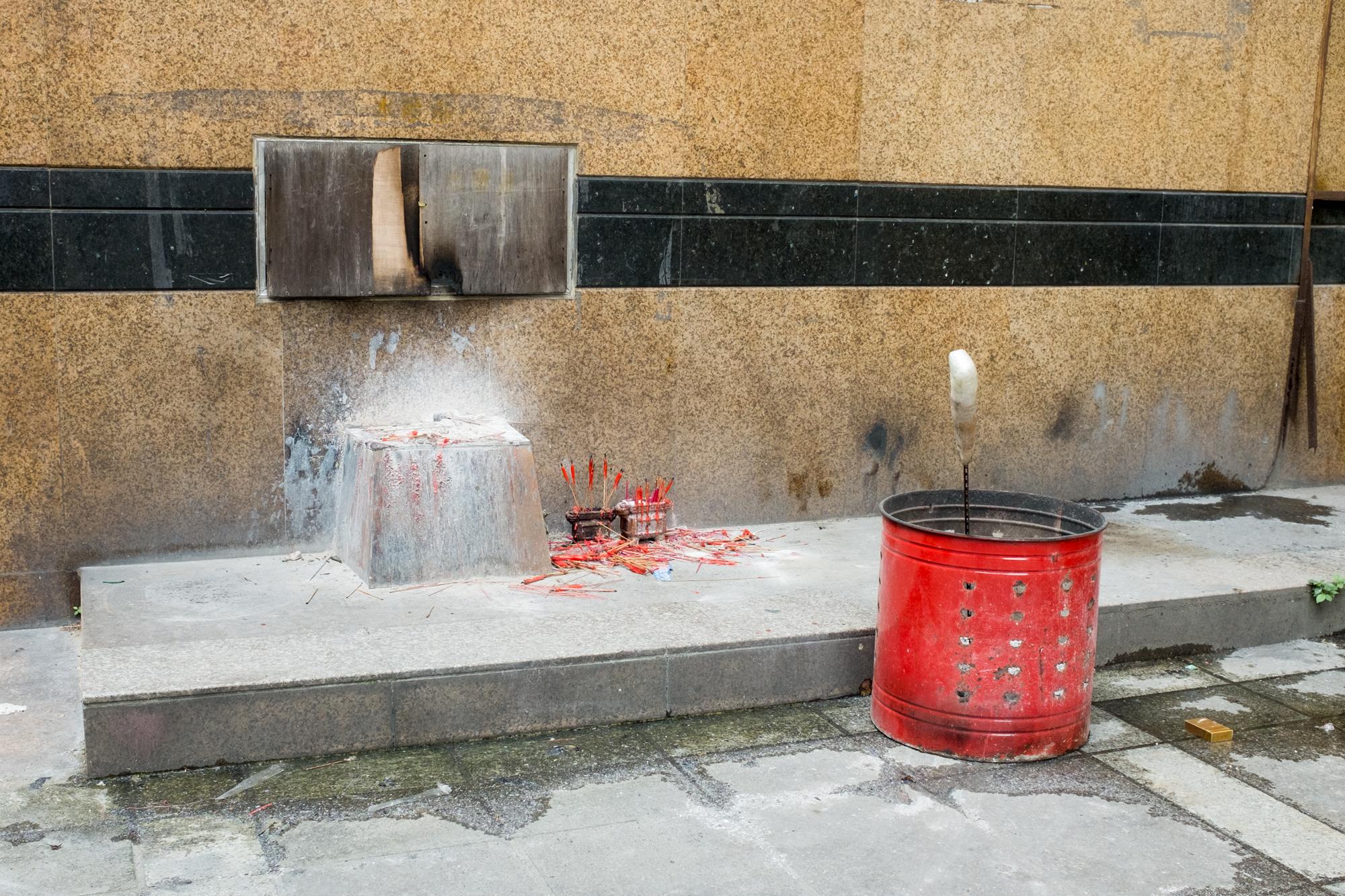 Burnt Incense near Buddhist Temple