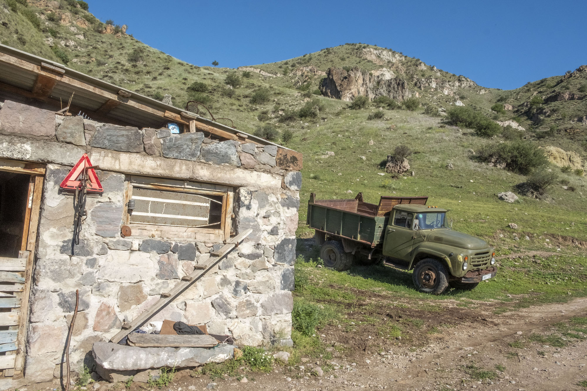 stone barn and russian truck.jpg