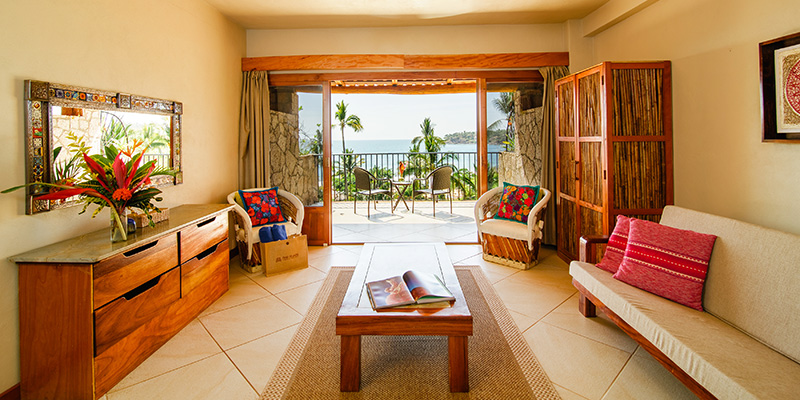 The Ocean Rooms are bright and airy, with floor-to-ceiling glass doors opening onto a private balcony with an Ocean view. All rooms have en-suite bathrooms with natural bath amenities.