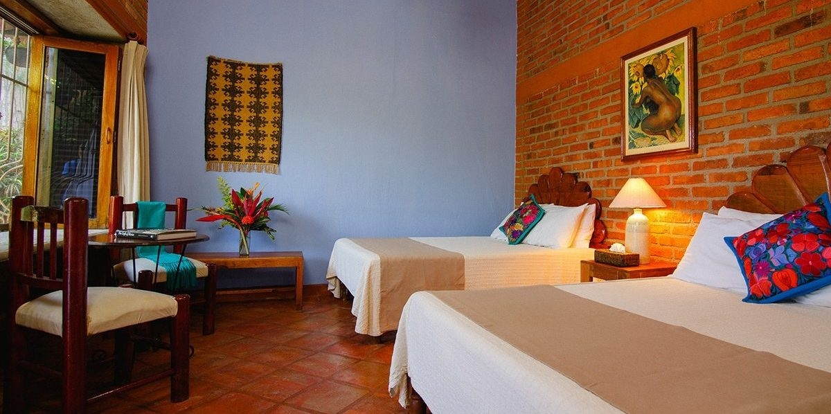 Guest Rooms are decorated in bright and cheerful Mexican textiles and colors, providing a cozy and well appointed option for those seeking simplicity and comfort. All rooms have en-suite bathrooms with natural bath amenities.