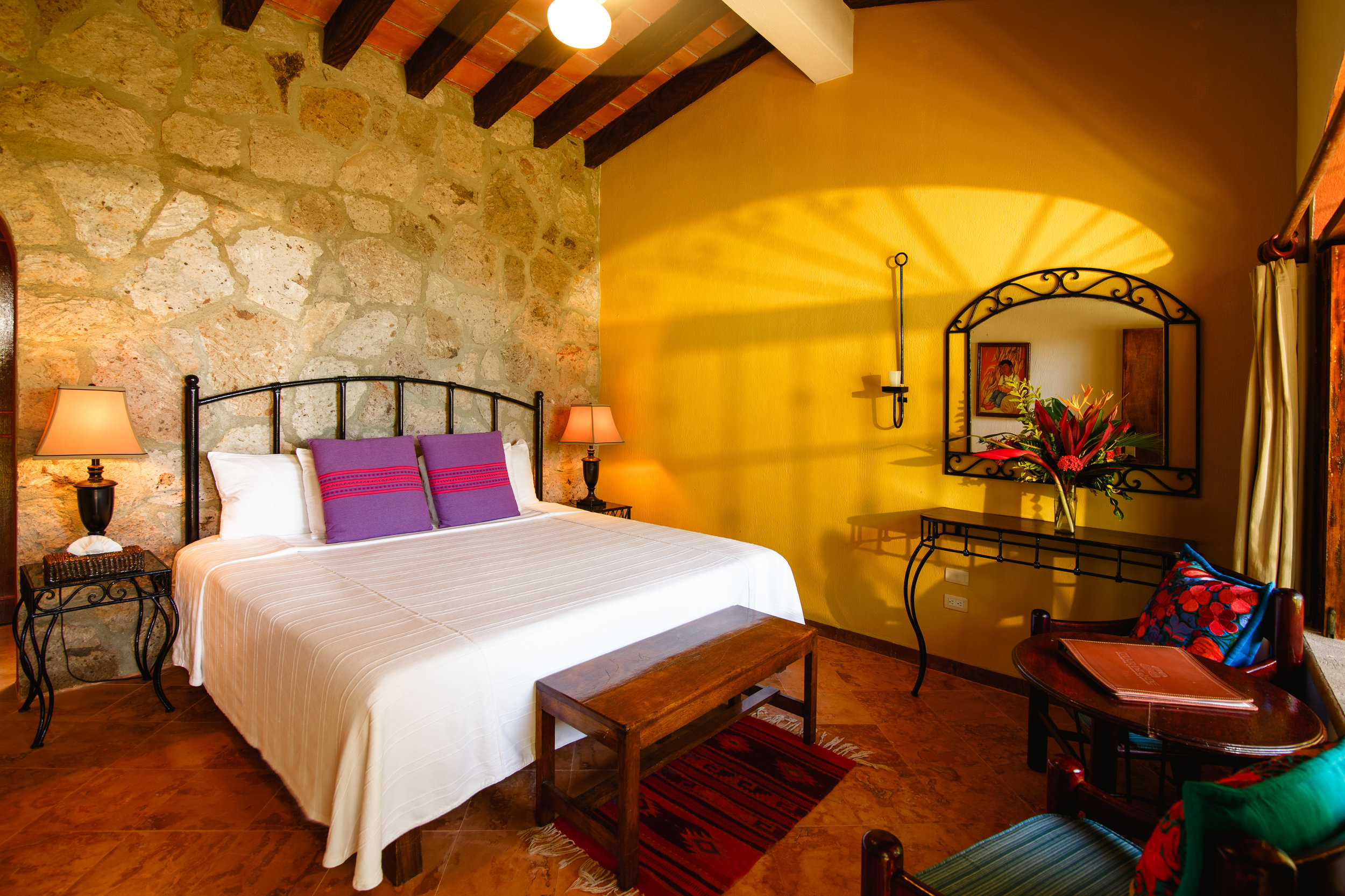 Garden Rooms are Mexican style, with natural rock walls and hand painted mosaics; or with an airy Mediterranean feel with floor-to-ceiling windows that let in plenty of natural light and fresh breeze. Each room has a spacious en-suite bathroom with natural bath amenities.