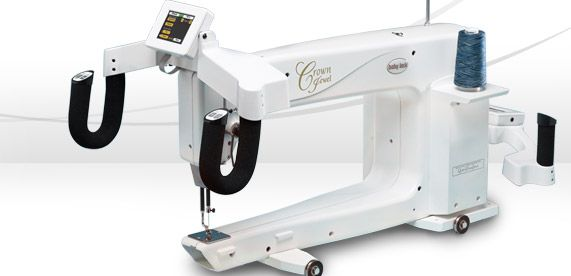 "The Crown Jewel longarm machine from Baby Lock allows you to create gorgeous and intricate quilting with an astonishingly smooth stitch for the utmost creative freedom and precision. With a generous 18"" longarm, you can achieve beautiful and professional-quality quilting with ease.  Effortlessly control every aspect of your quilt with a large LCD on the front and back handles.  Enjoy the satisfaction of adding the final touch with the Crown Jewel.   WATCH THE CROWN JEWEL VIDEO"