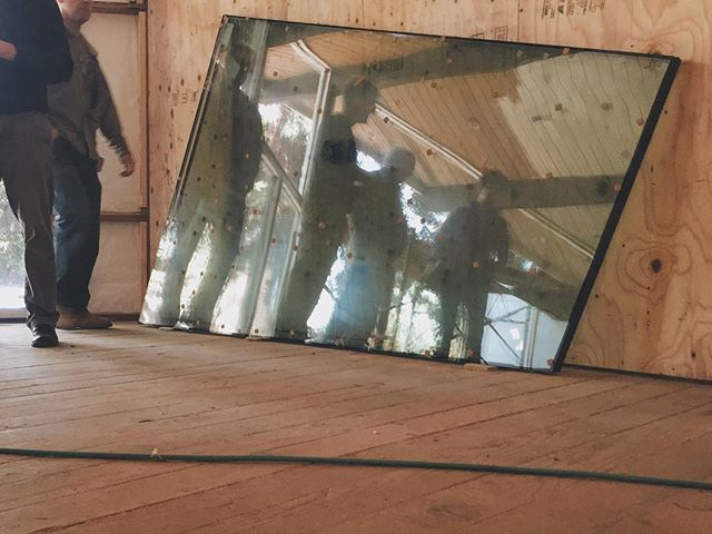 Looking at trapezoid glass at trapezoid living rm.  #blredwoodhouse  #dwellrooms #vsco