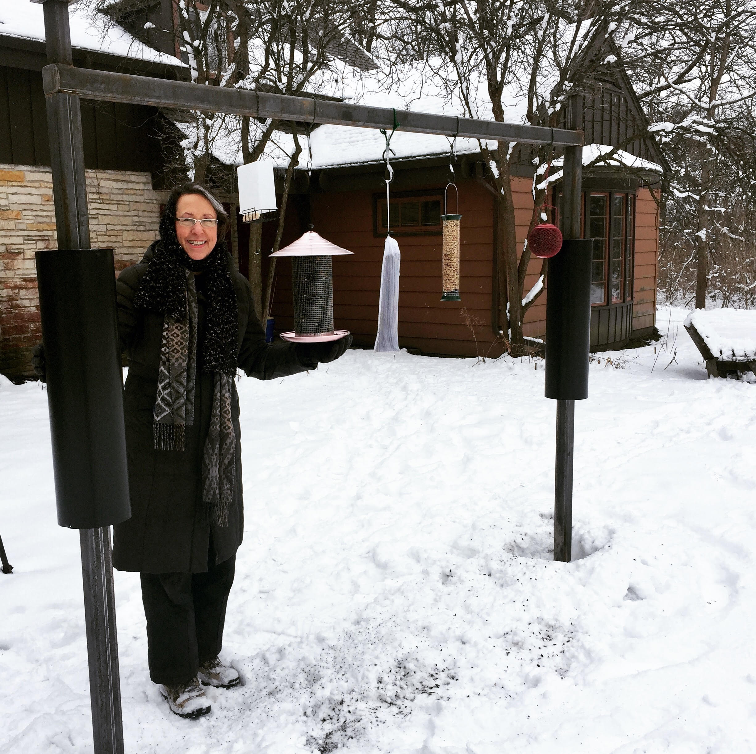 Board member Patty Oliveri feeding the birds in the winter months at Severson Dells Nature Center.