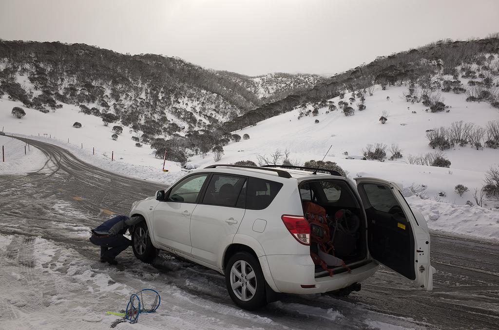 Gav putting snow chains on the Rav