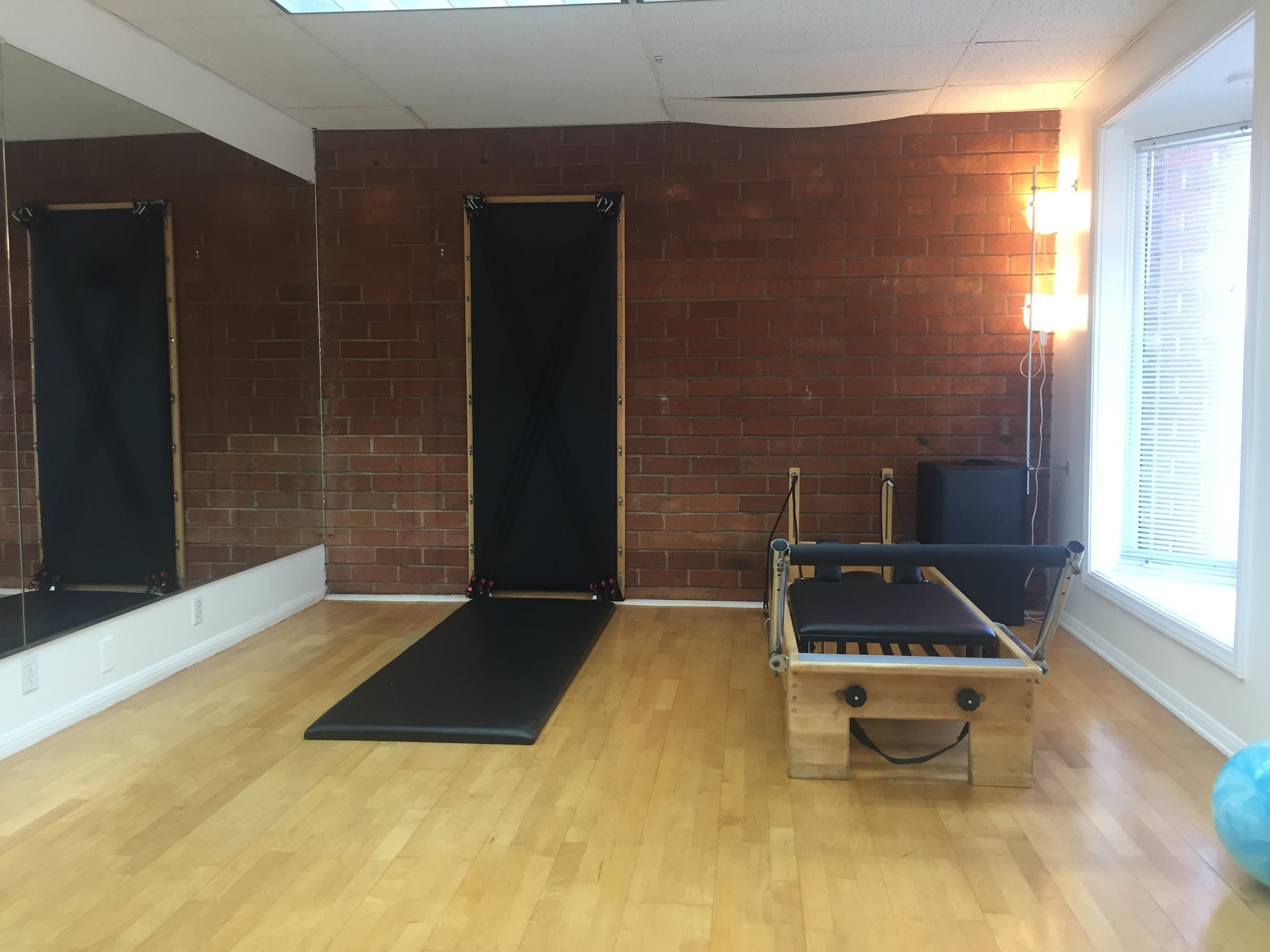 "STUDIO 2*  Perfect for clients who require absolute privacy. 200 Sq ft.  1 Reformer and 1 wall unit.    TO RESERVE CLICK HERE     Usage of STUDIO 2 is $45/hour.     * when booking this space online select ""STUDIO 2"""