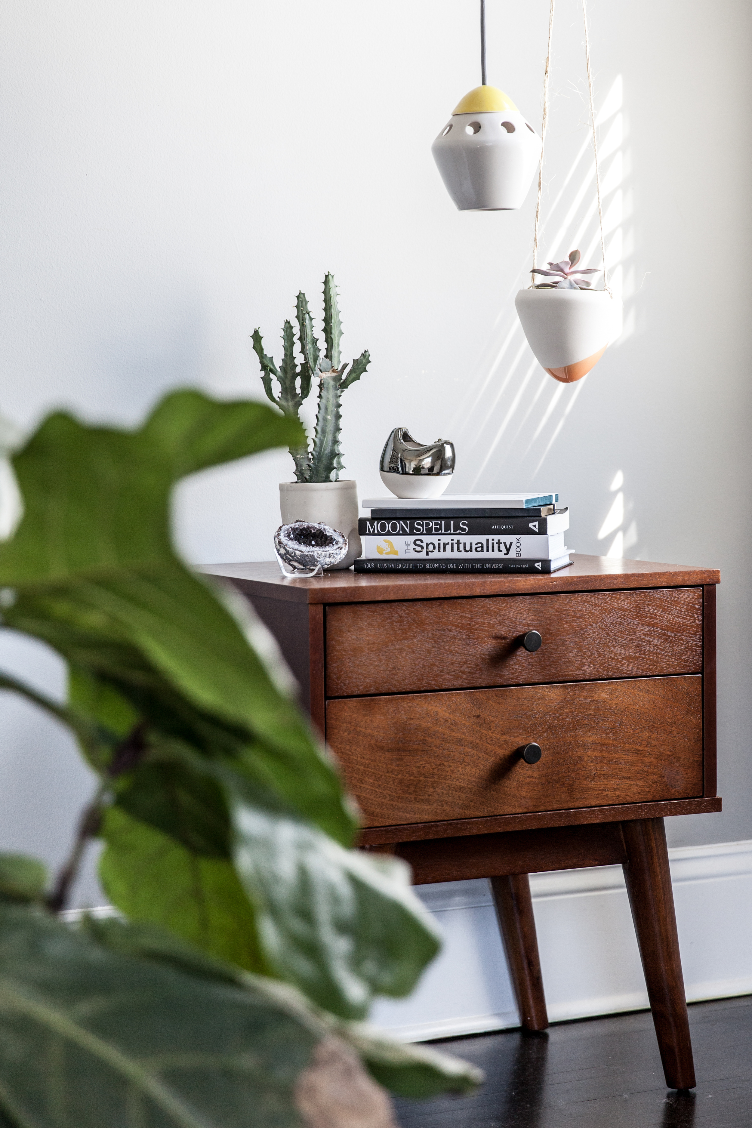 This side table got a dreamy set up with the ' Stamper ' succulent planter, ' Garden Bomb ' hanging succulent planter, ' Choir ' votive, and small ' Rocket ' pendant light.