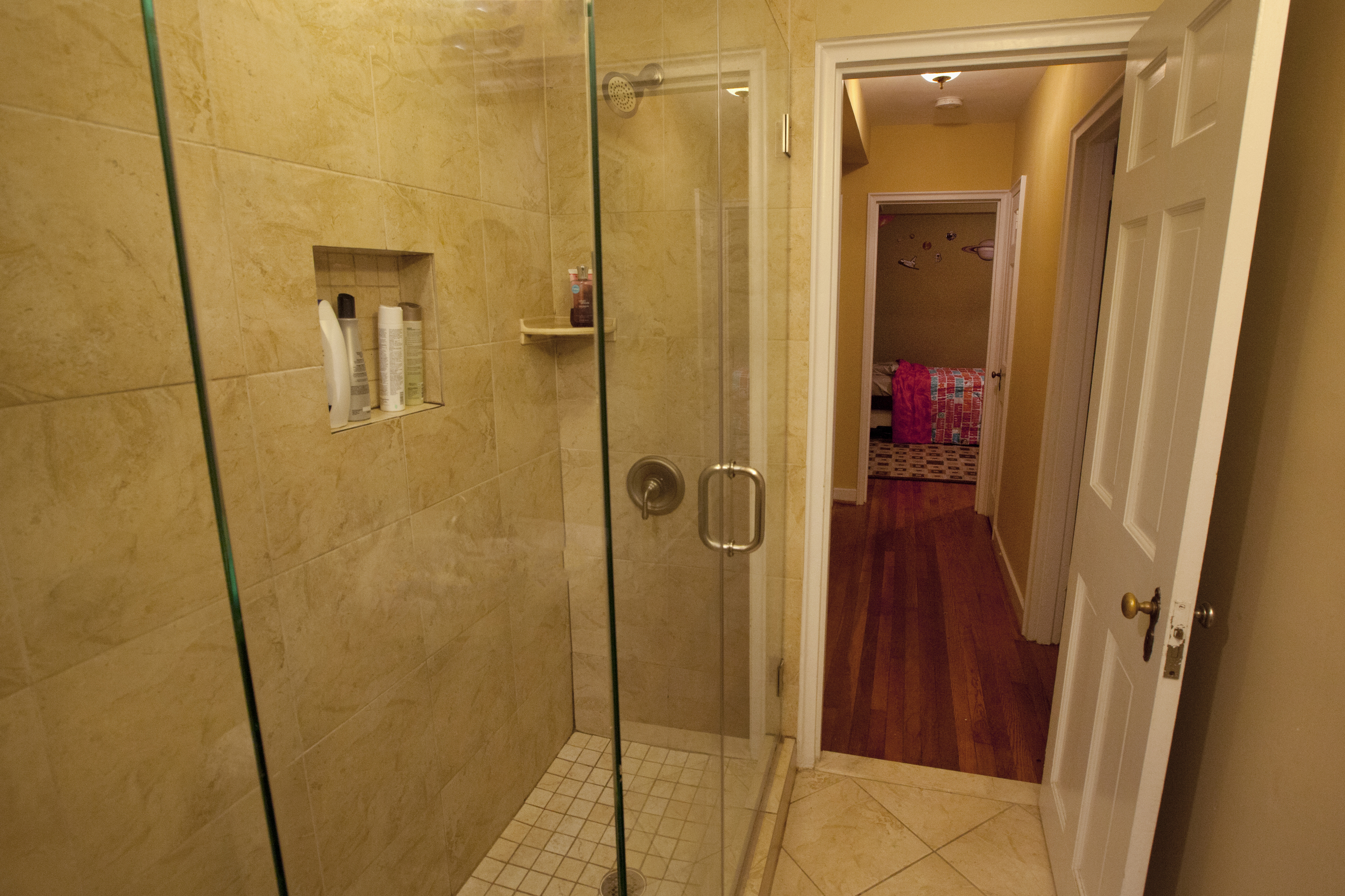 Glass shower makes the most use of the space.