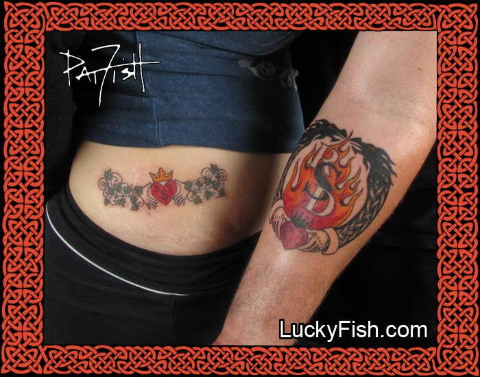 A pretty combination of ivy vines and spirals complement the claddagh tattoo traditional symbol. A dedication tattoo with timeless heritage.    Two dragon heads meet above a traditional claddagh tattoo, with flames of passion rising inside the ring, here shown as an ideal place to feature initials or the name of the beloved.