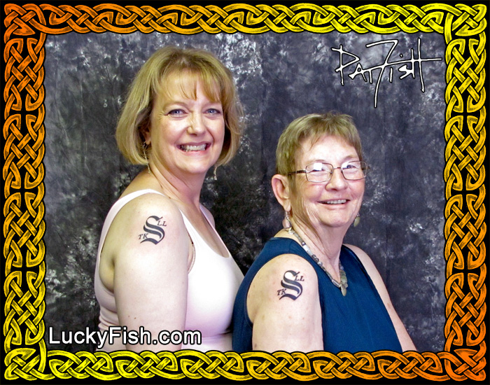 Mother and Daughter with matching family monogram tattoos  by Pat Fish
