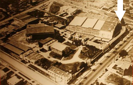 In this 1914 aerial photo, you can see that the studio complex took up the entire block surrounded by Chapala, Padre, Mission, and State Streets. The arrow indicates the approximate location of the tattoo studio today, near the corner of State and Mission. The only original building that survives today is the small white one at the very bottom of the photo on the corner of Chapala and Mission.
