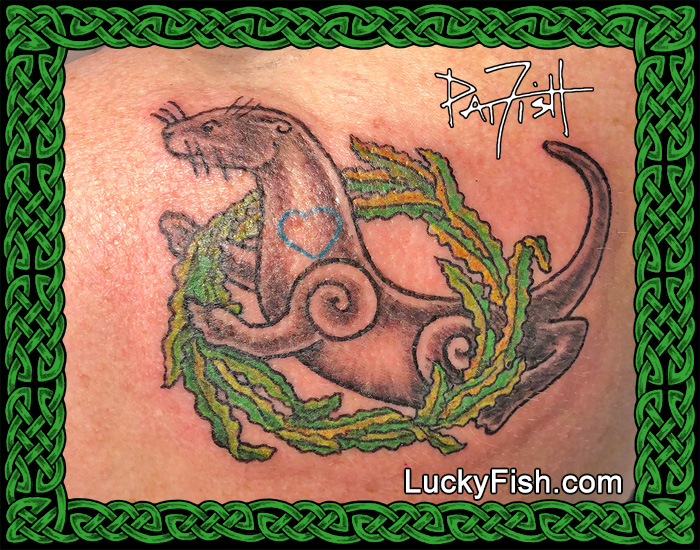 Sea otter tattoo by Pat Fish