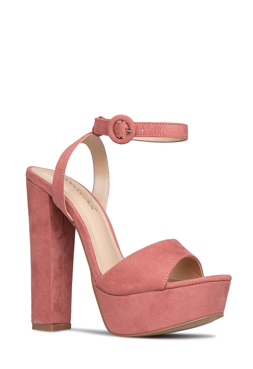 These aren't the exact shoe I have on but I did get mine from ShoeDazzle. Mine are from 2 years ago. Very similar.