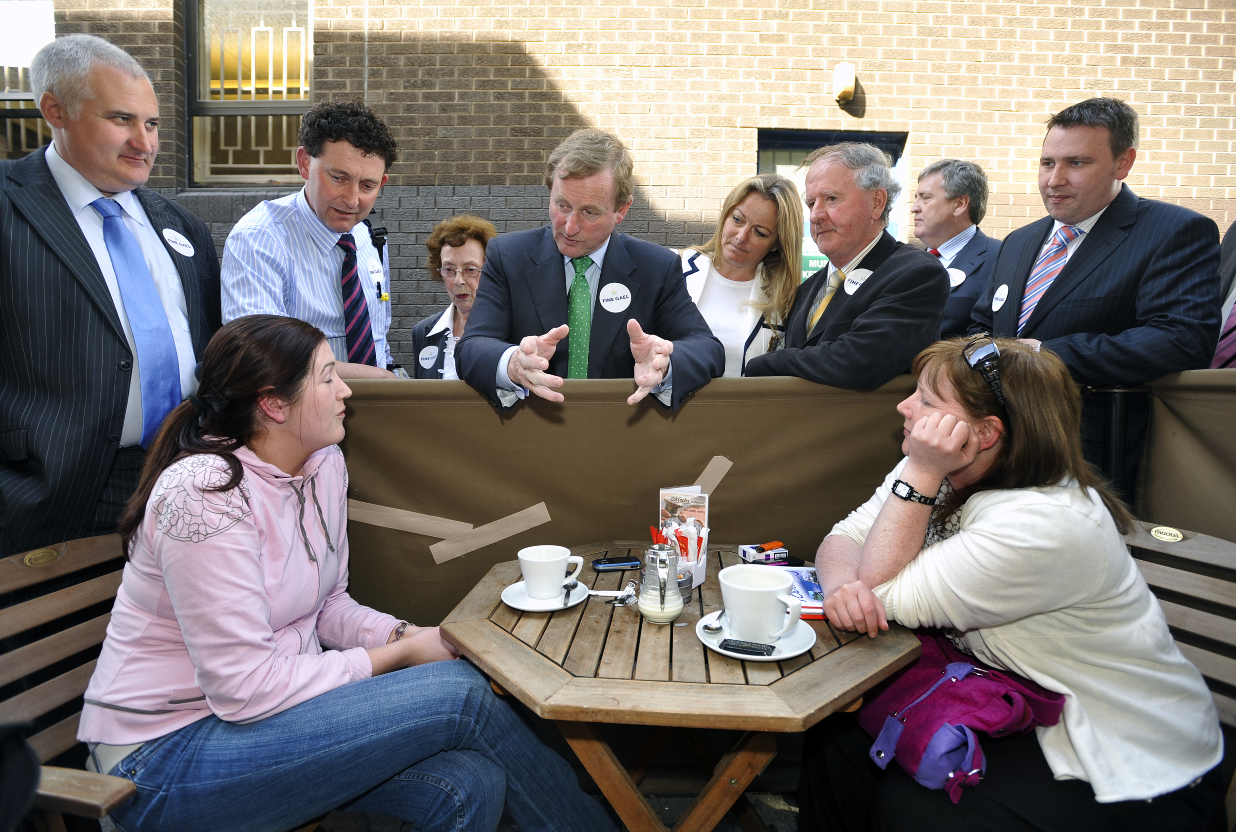 Fine Gael leader Enda Kenny engages with some Al fresco diners during his visit to Ennis. Looking on are candidates Roger Fox, Johnny Flynn, Mary Coote Ryan, Mary Howard, Gabriel Keating and TD's Pat Breen and Joe Carey.
