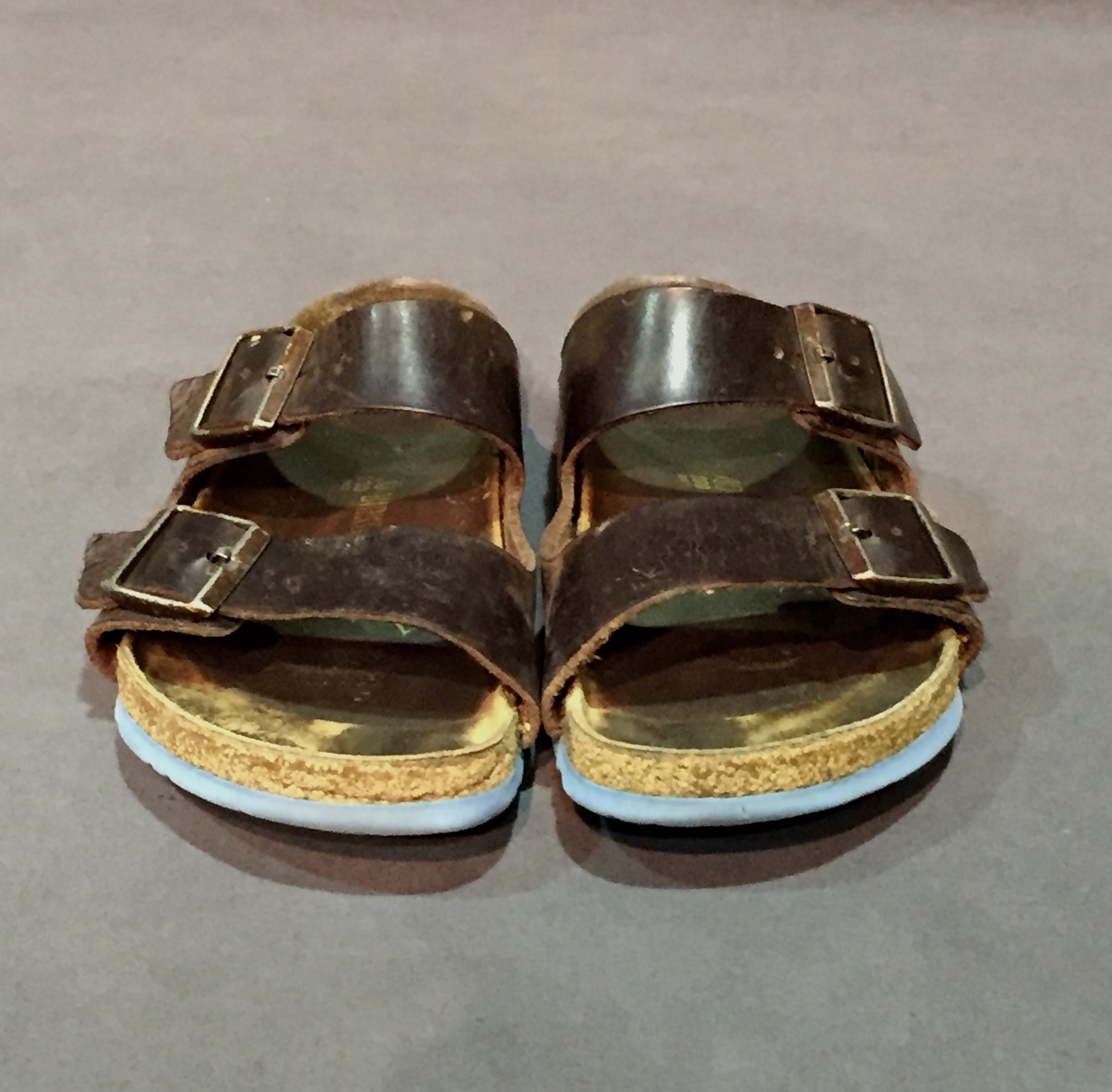 """- Birkenstocks (brown sandals); Owner – Cyndi, lesbian, woman, 42, lives in Iowa; c. 2010s""""I had worn some sort of dress pant with Birkenstocks and I had a thumb ring on, and he was like, 'oh man, you're an old-school dyke' and I was like 'No I'm not, I don't have ill-fitting pants, I have short spikey hair.' So, we had a whole conversation because he was actually really close to my age, but having someone refer to me as an 'old-school dyke' because I had Birkenstocks and a thumb ring was really interesting to hear, cause I didn't think about that."""" – personal interview with Cyndi, November 21, 2017"""
