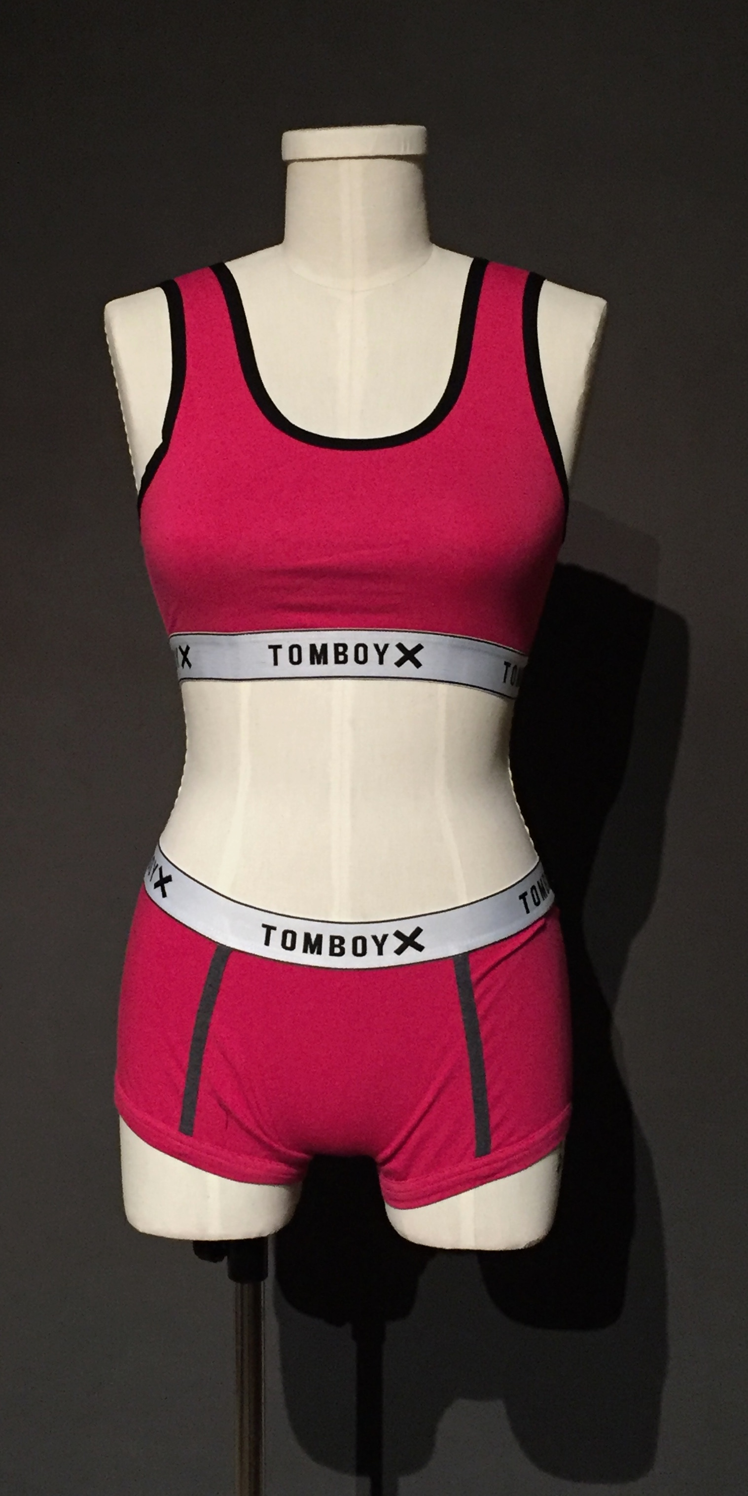 """- Pink sports bra and boxer brief;Owner – TomBoyX;2017""""We wanted to be that brand that, that lets you be unapologetic about who you are, all day every day. Just to feel comfortable in your own skin."""" – personal interview with Fran Dunaway, founder of TomboyX, November 11, 2017""""I love seeing it every time someone posts that this is the thing that makes them feel comfortable in their own skin. And we're saying that again because that's literally the, that's what it is. It's, feeling empowered, and feeling really good about yourself. And, that's a challenge for a lot of people. So, if we can help in that."""" – personal interview with Naomi Gonzalez, founder of TomboyX, November 11, 2017"""
