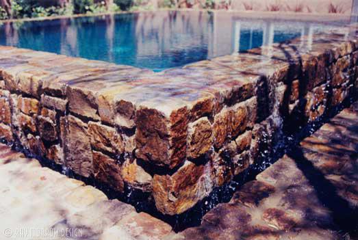 stone-pool-overflow-edge-closeup-jones-newport-ridge-north.jpg