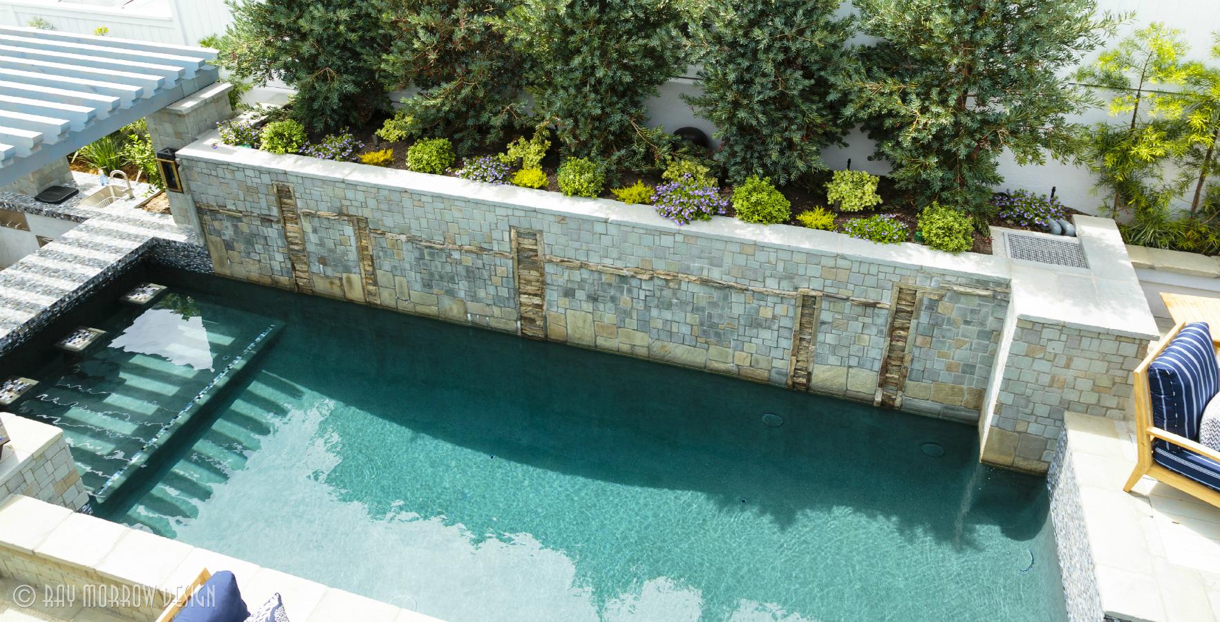 pool-with-swimup-bar-fountain-wall-cottle.jpg