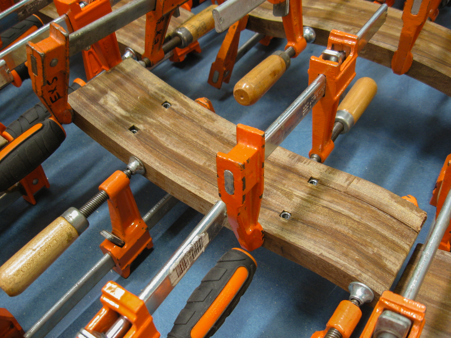 The arm rests were constructed out of four CNC routed pieces, with slots to hold captured fastening nuts