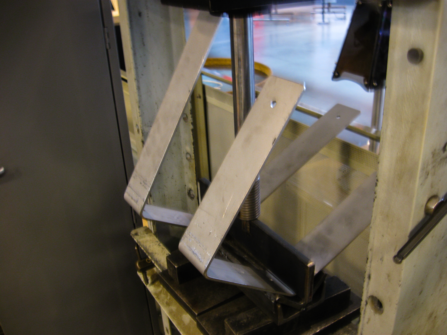 Bending the brackets that hold the chimes