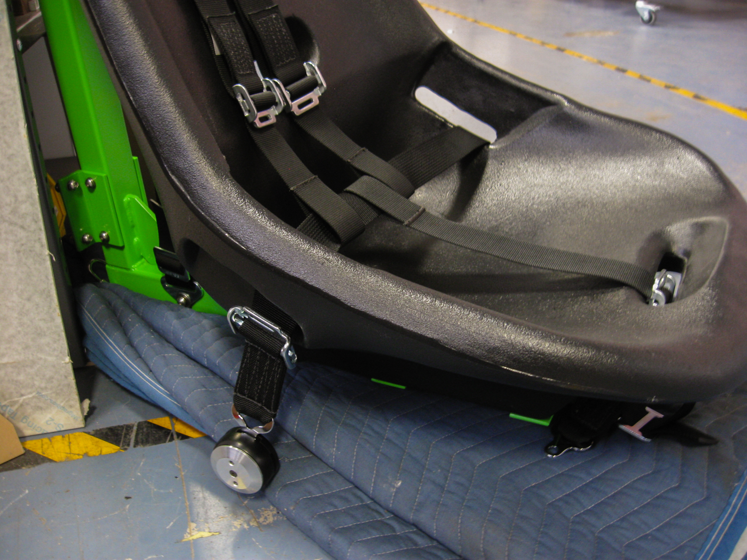 Testing an alternative strap configuration with the buckle under the seat