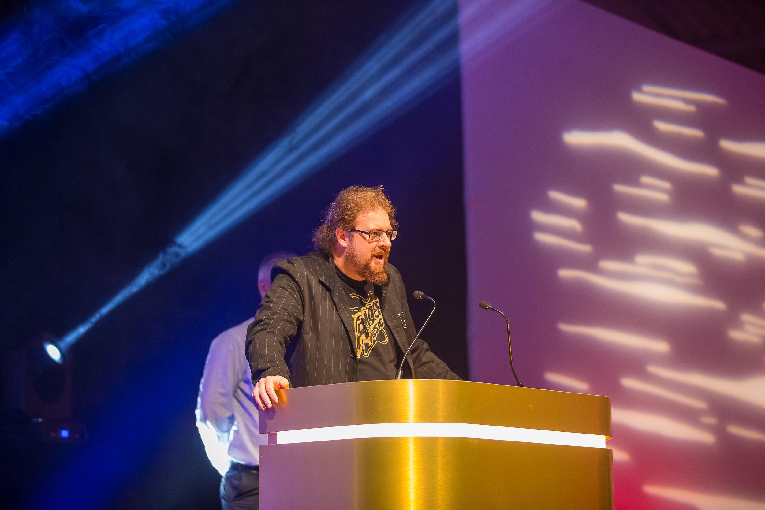 Tom Girard giving a winners speech for winning the Arts Contribution Award.