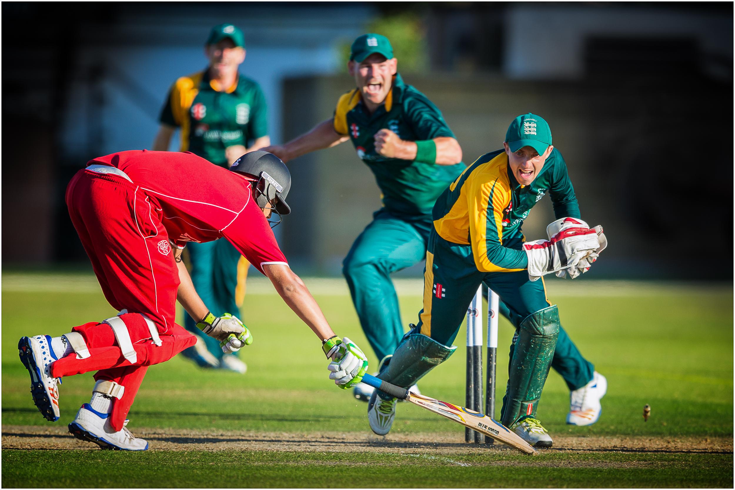 Jason Martin runs out a Danish batsman in a Guernsey v Denmark game at KGV Playing Fields in 2017...