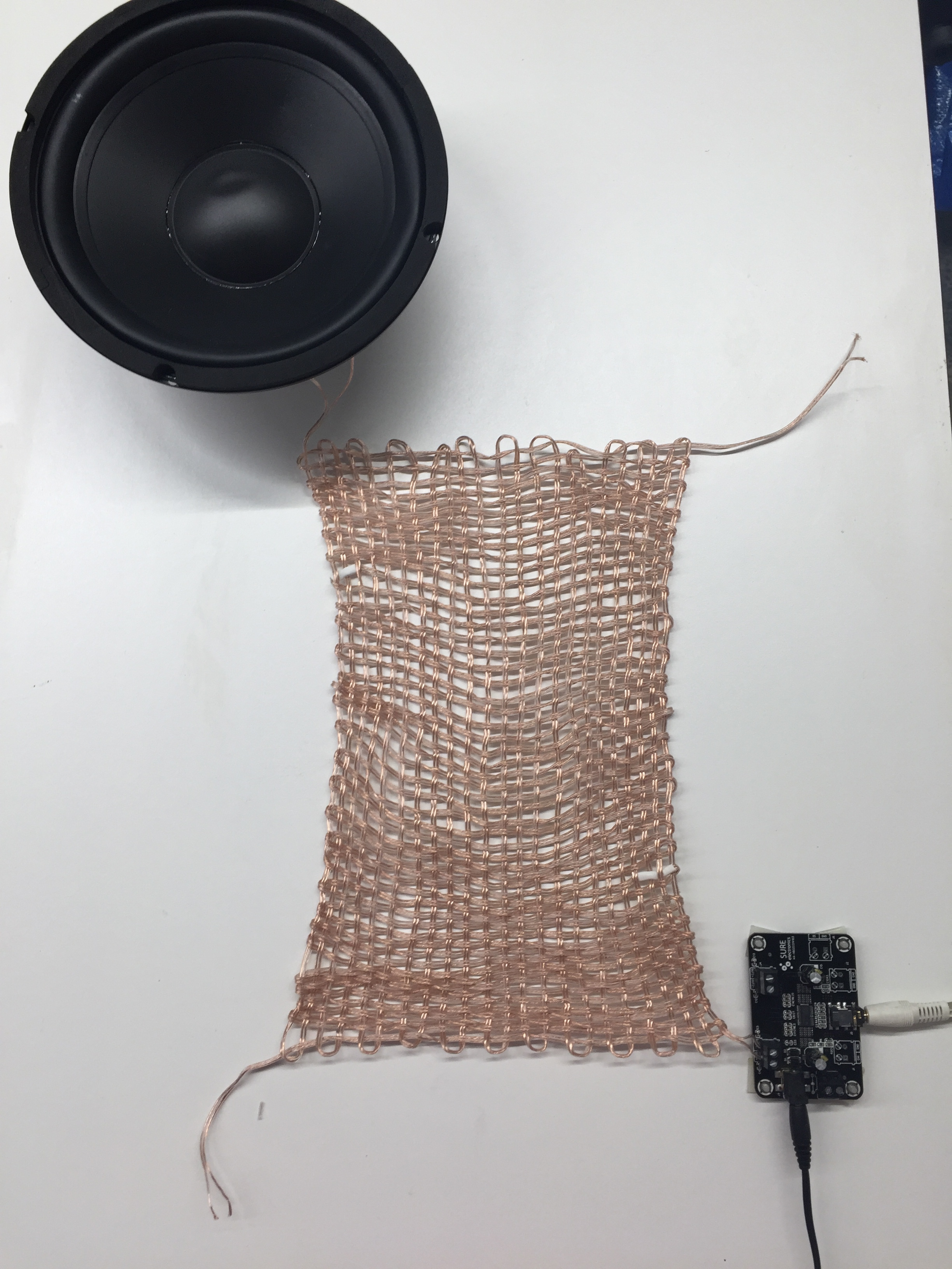 The amplifier is attached to one end of the warp, and the other end of the warp to the speaker. I could also connect the weft ends to their own speaker/amplifier pair.