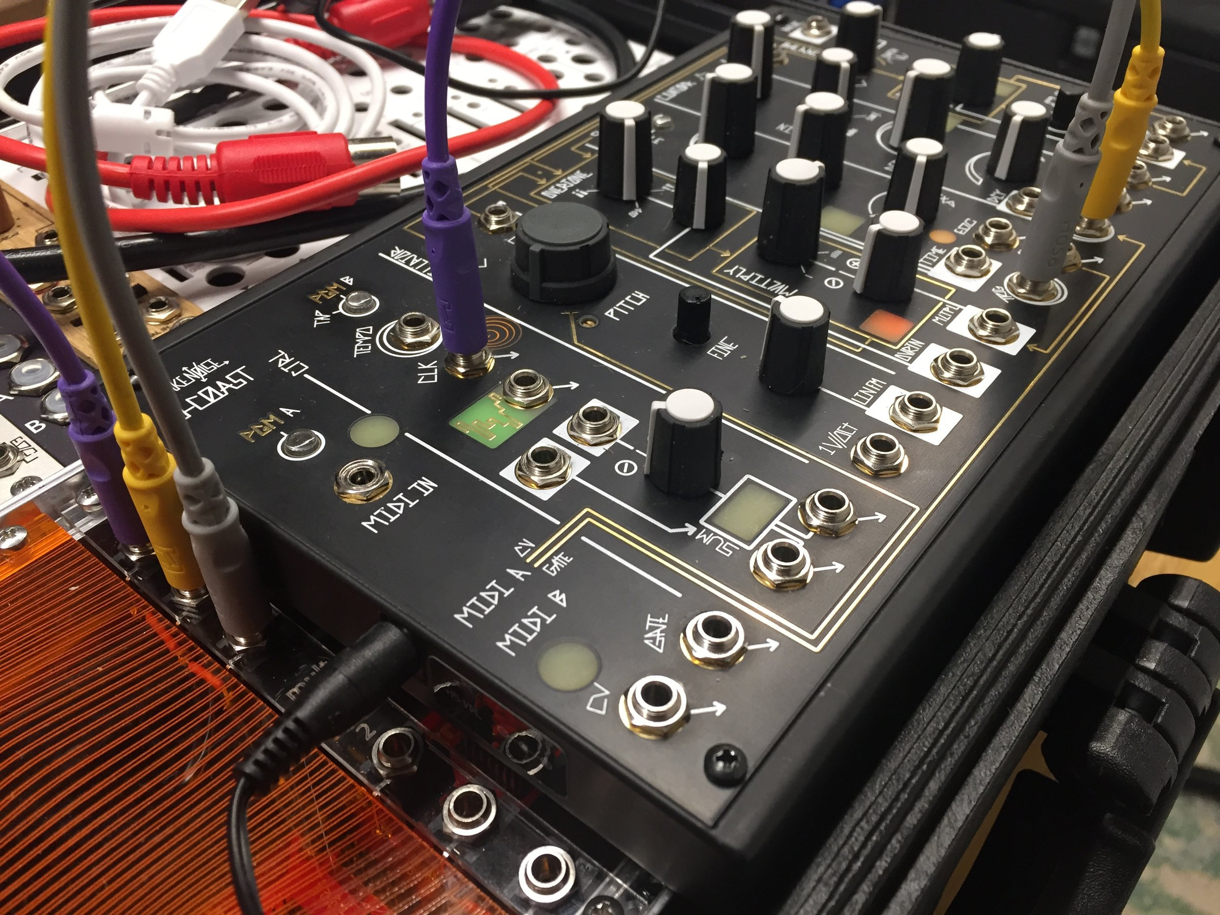 """Sending the clock output to the multiplier, and then back into the synthesizer to trigger both """"slope""""and """"cycle"""" circuits."""