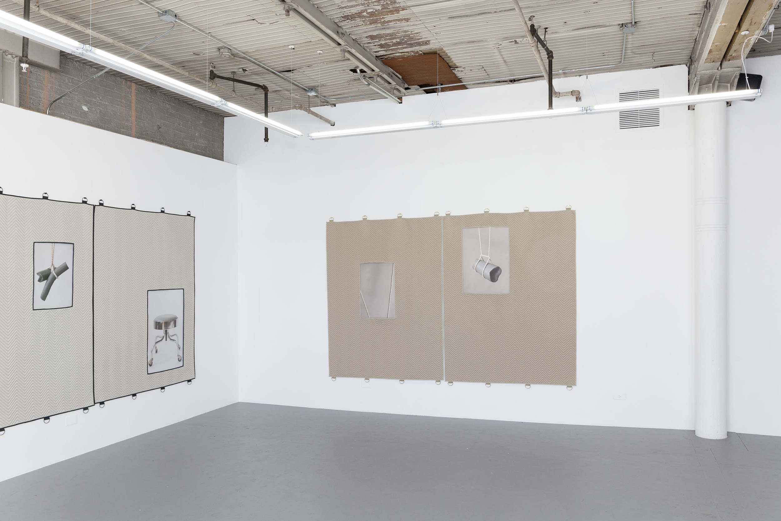 A collaborative project with Christalena Hughmanick uses rejected Burberry raincoat fabric in the form of moving blankets as a framing device. The photographic images housed within explore abstracts, a fragmented index of information from the beginning of known documented knowledge pertaining to surgical knots. Suspended knot braces become the support for sculptural clay forms, which are reminiscent of the body. Moving blankets deprived of their imagined utility have become the framing units for studies of surgical knots. These knots have three origins of intended use but the focus has been placed on how the knots hold a patient in position.