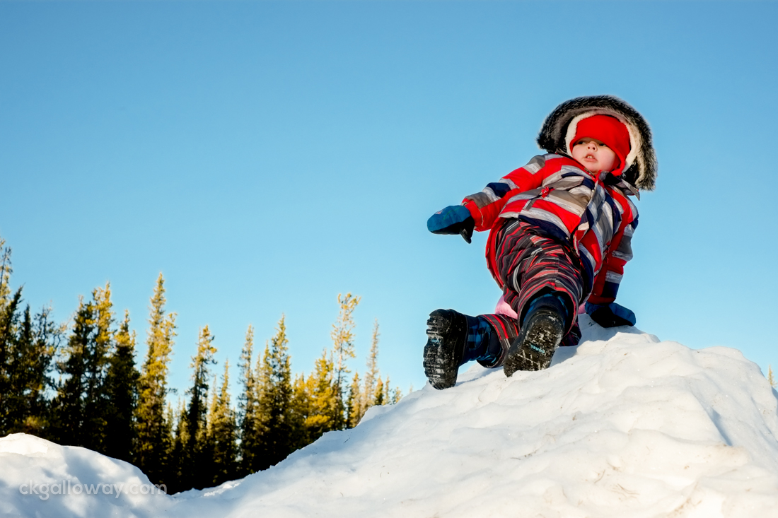 Oscar climbing the snow hill at Lorne Mountain Community Centre. At one point he stood wobbling at the top of the hill, jumped in the air as high as he could, and slid down to the sound of gasps from onlookers.