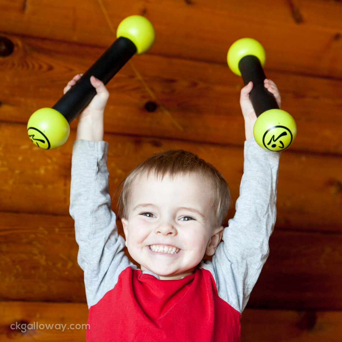 My three-year-old son Oscar with Zumba weights.