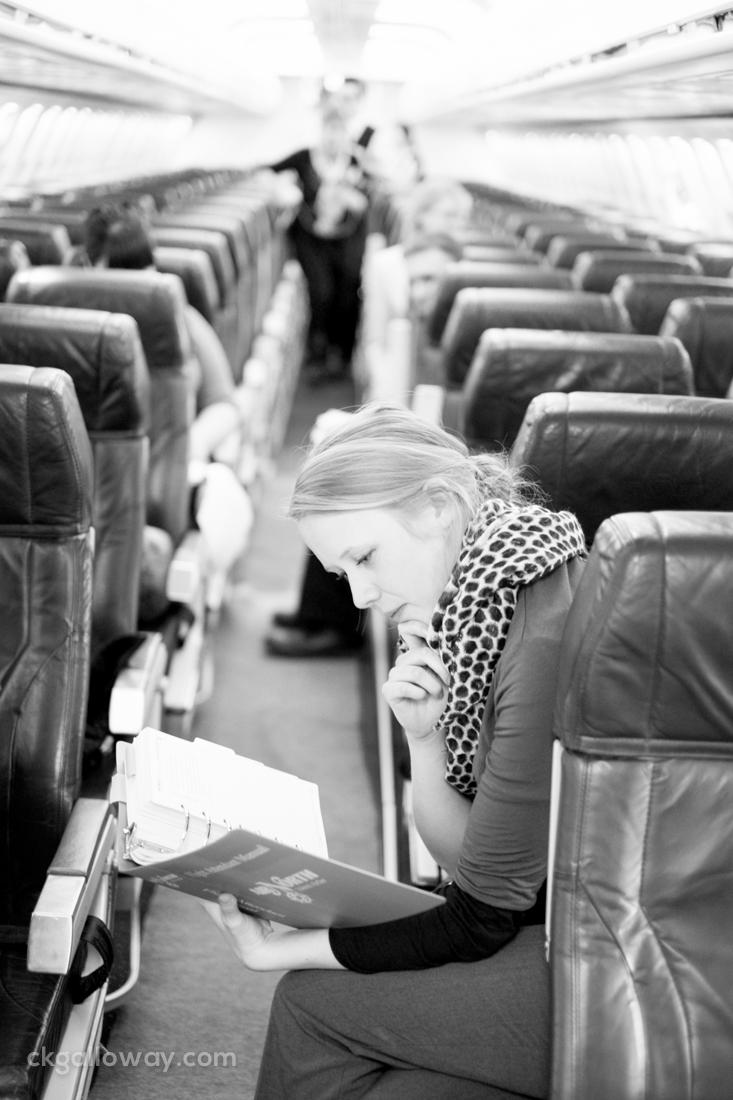 FA trainee Susan Gregory Allen studies the FAM (Flight Attendant Manual) onboard a B737.