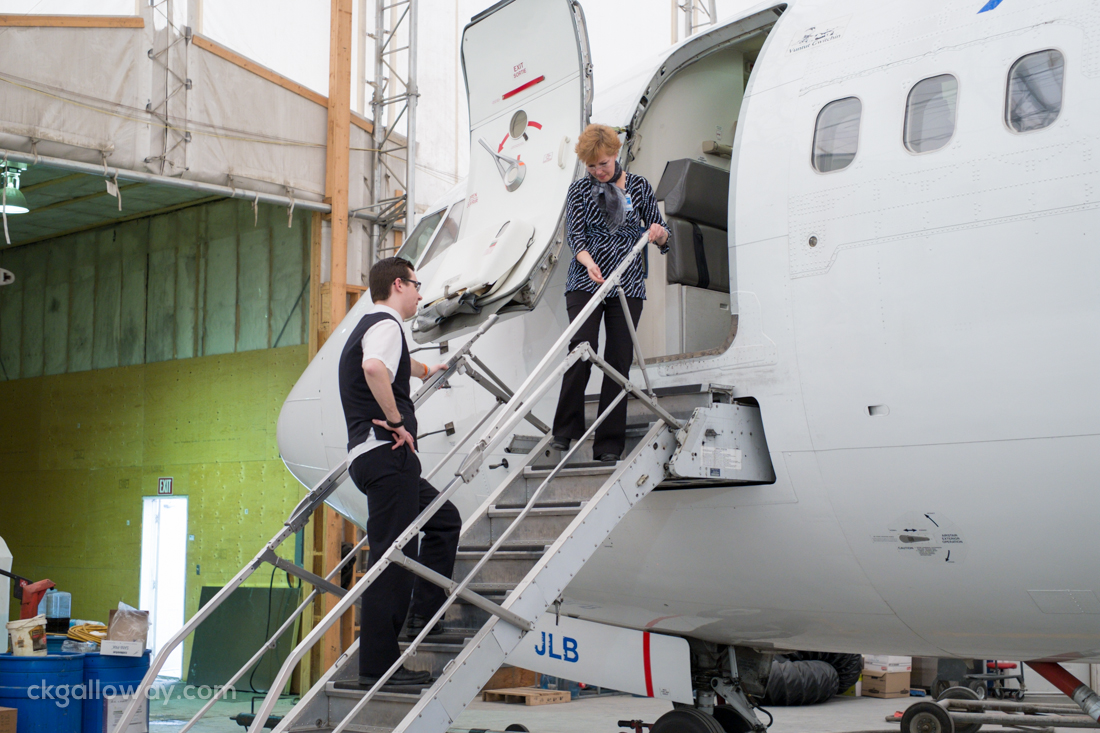 Instructor Michael Sofko supervises Sonja retracting the airstairs on a B737. Photo by Christa Galloway.