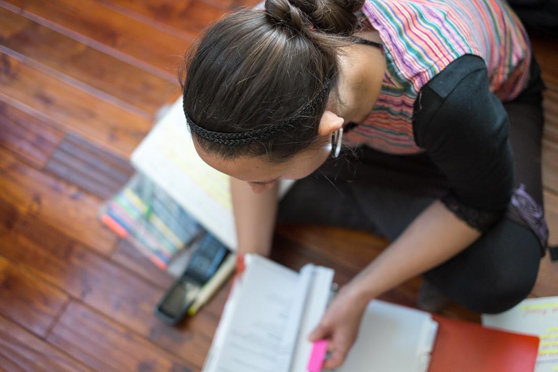 Erin Sanderson studies the FAM (flight attendant manual). Photo by Christa Galloway.