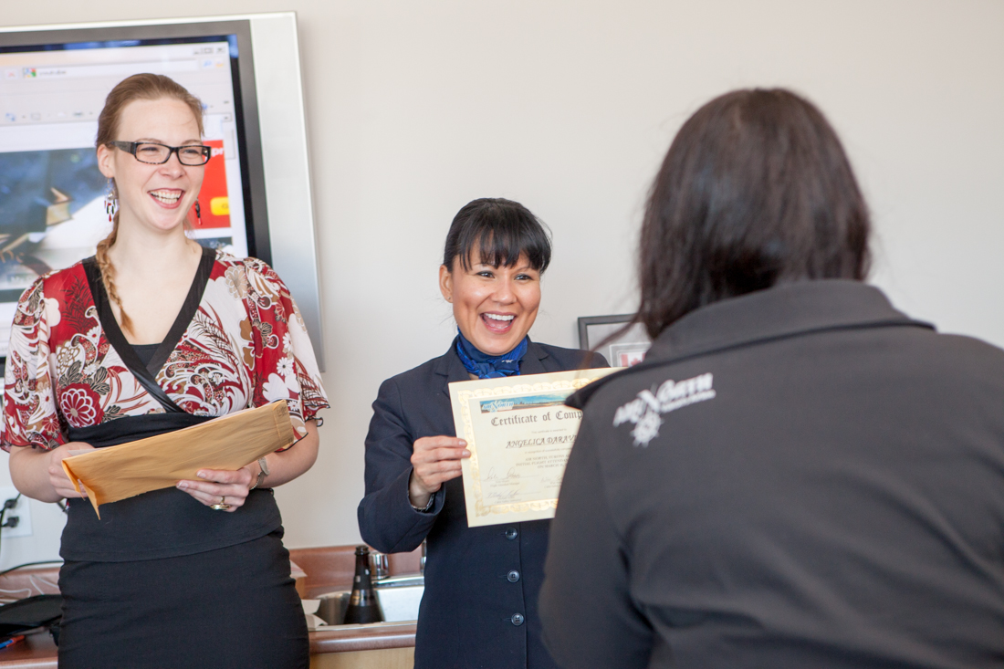 Angelica receives her certificate from Wini and Roxanne.