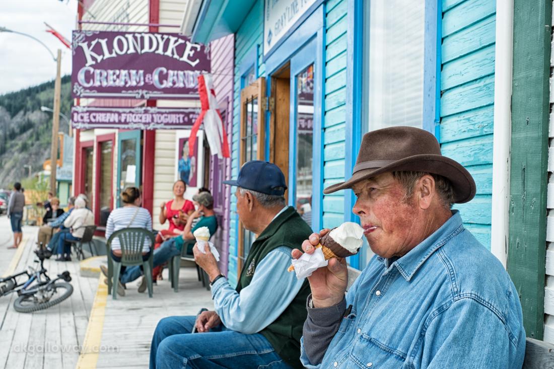 A farmer from Mayo enjoys an ice cream from Klondyke Cream & Candy in Dawson City. Photo by Christa Galloway.