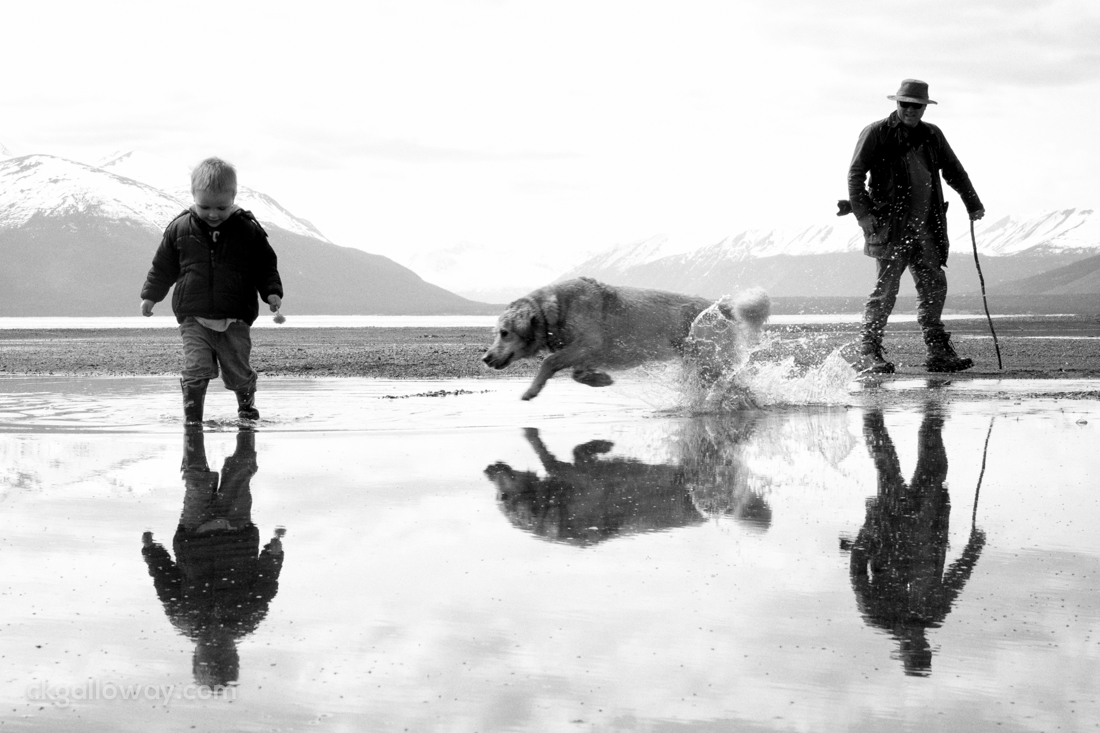 Richard, Oscar and Maggie enjoy some family time on the beach at Atlin Lake on Saturday.  Photo by Christa Galloway