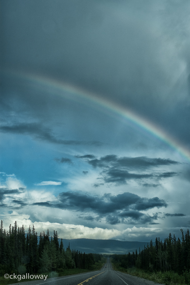 Chasing a rainbow on the Alaska Highway near Teslin.