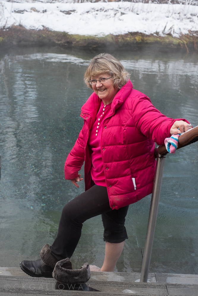 My mother dipping her toe in the Liard hot Springs, November 2014.