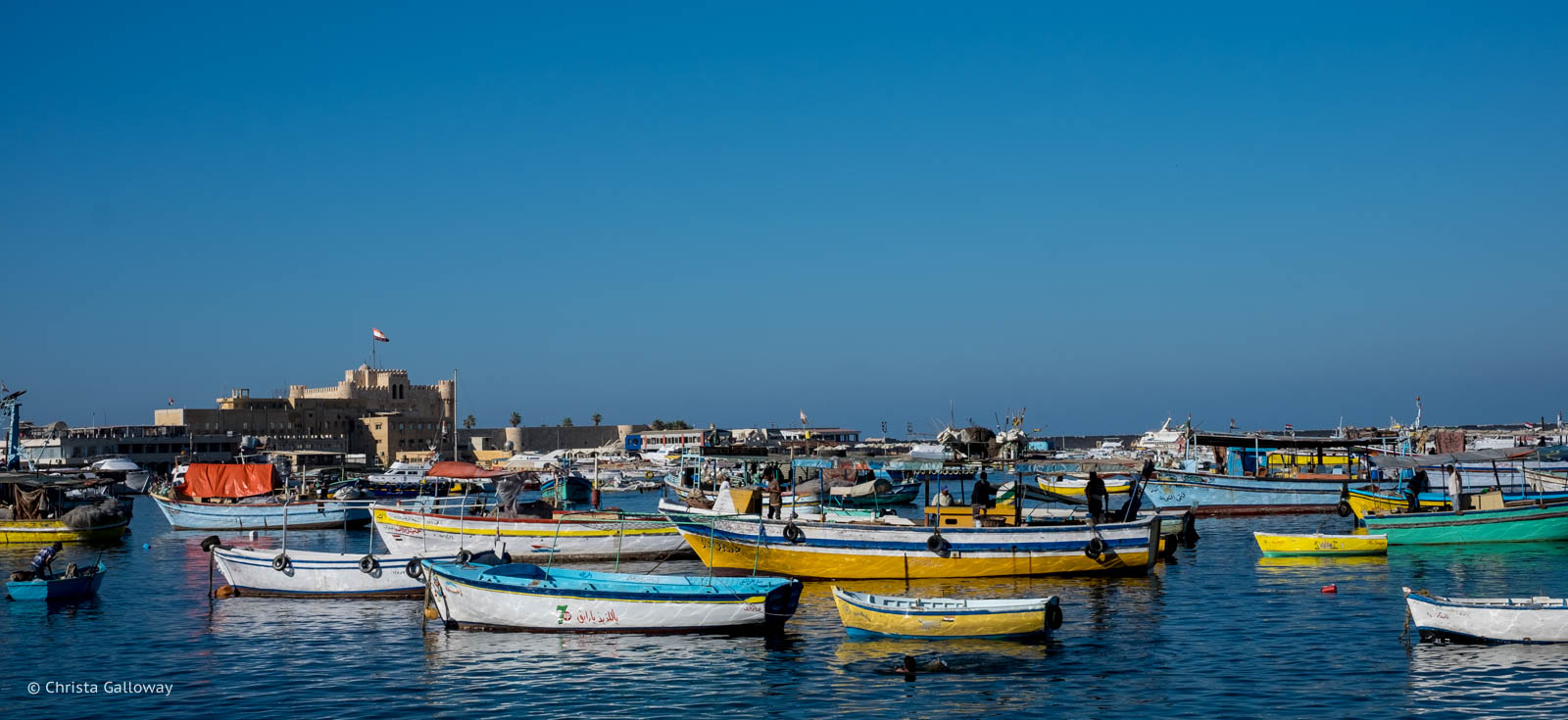 Boats on the Mediterranean coast near the Qaitbay Citadel.