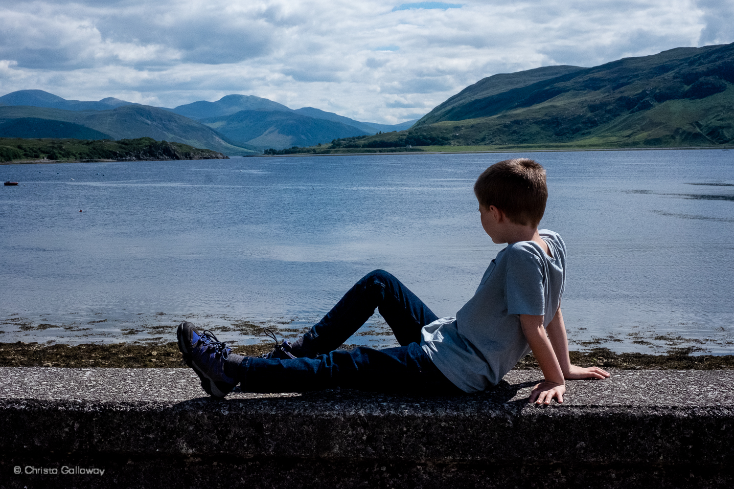 Oscar Galloway looking out over Loch Broom in Ullapool. Photo copyright Christa Galloway.