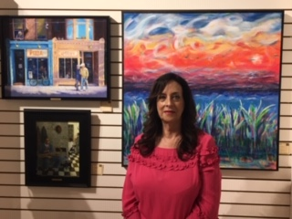 Judge for art show pictured in front of some entries