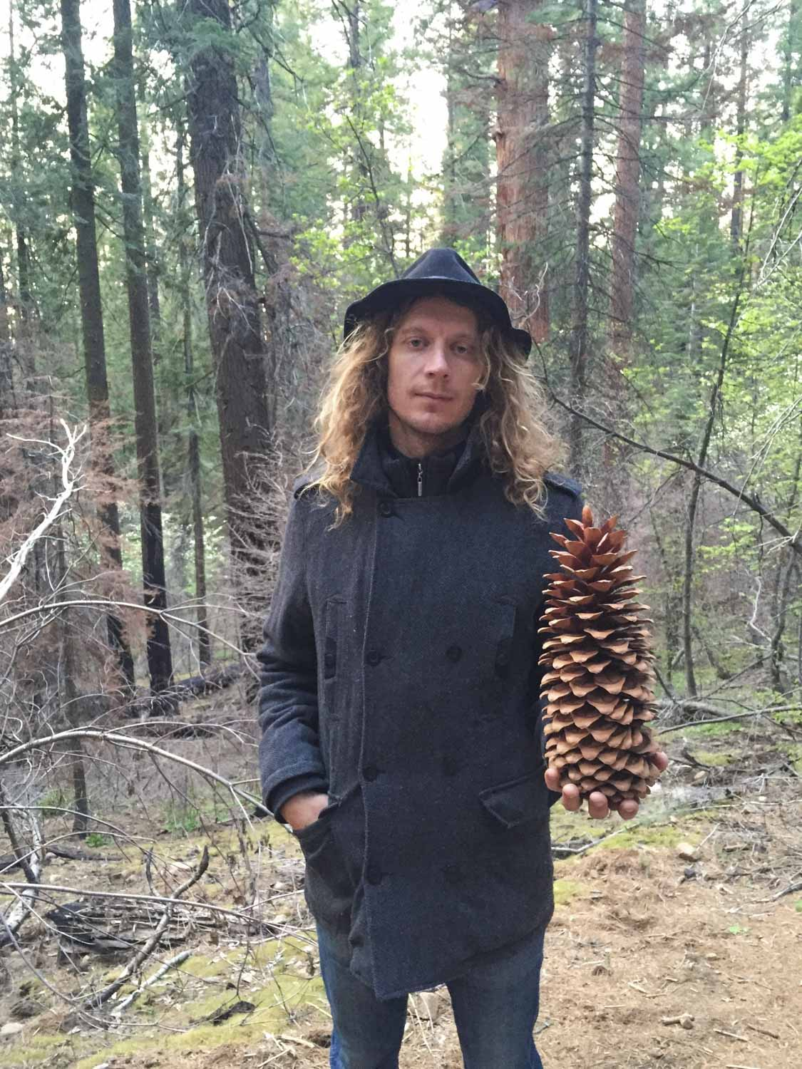 Matty holding a Red Wood Tree pine cone