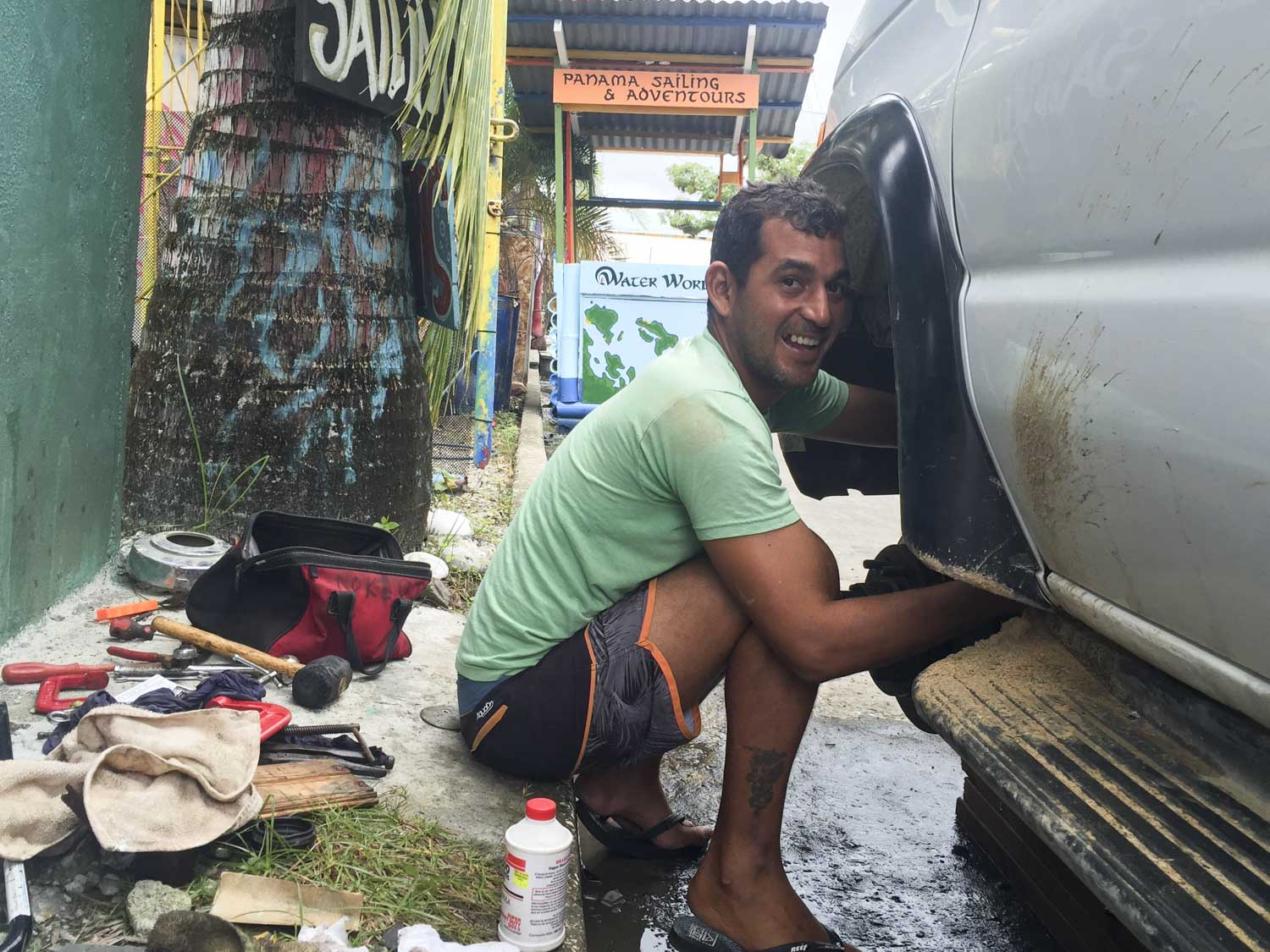 Improvising mechanic on the side of the road