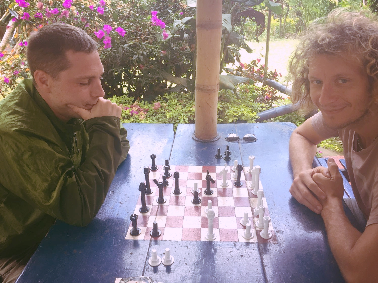Playing chess with Alex, notice the chess pieces are made of nuts and bolts. Matty painted them and brought them back to life