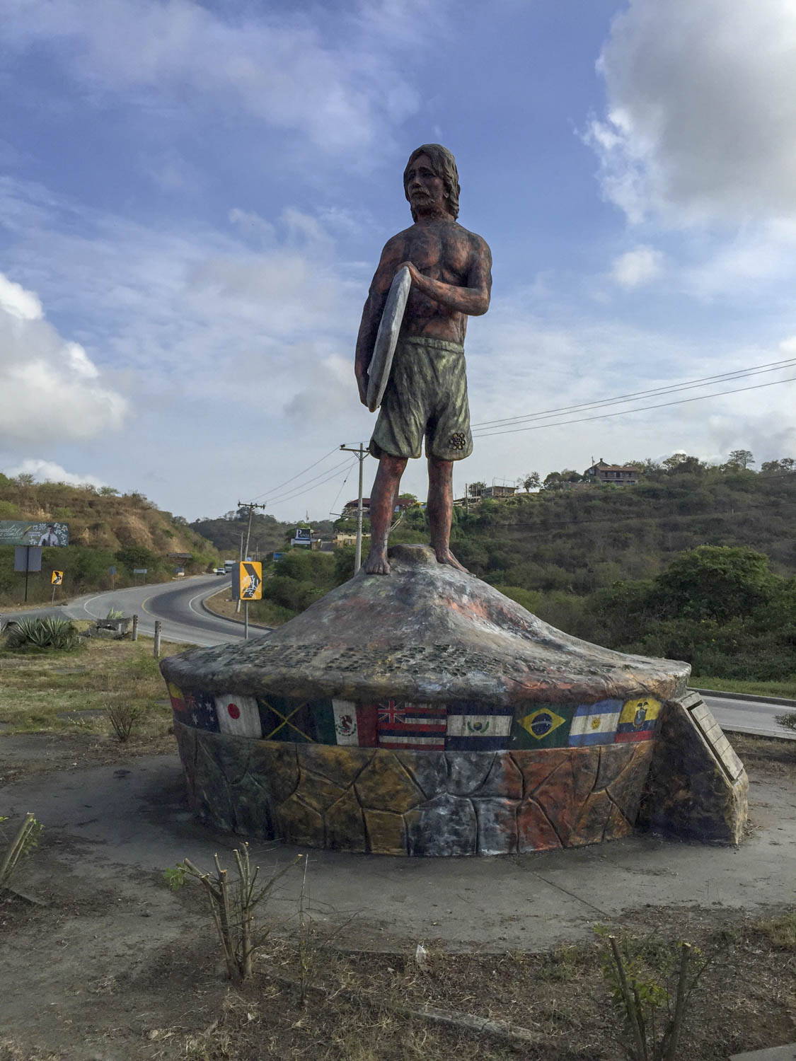 A friendly statue welcomes you to the surfer's parking lot where we got robbed